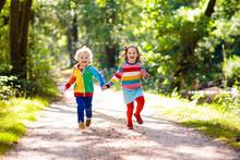 Kids Play In Autumn Park