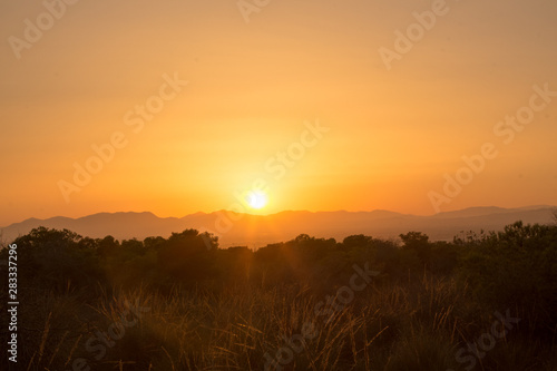 HDR image of a sunset behind the mountains during a warm Summer evening in Augsut seen over Alicante City