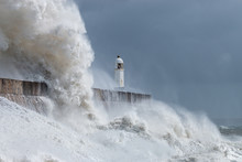 Huge Ocean Waves Crashing Into A Sea Wall And Lighthouse (Porthcawl, South Wales, UK)