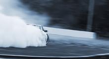 Car Drifting, Burning Rubber Wheel Drifting With A Lot Of Smoke.