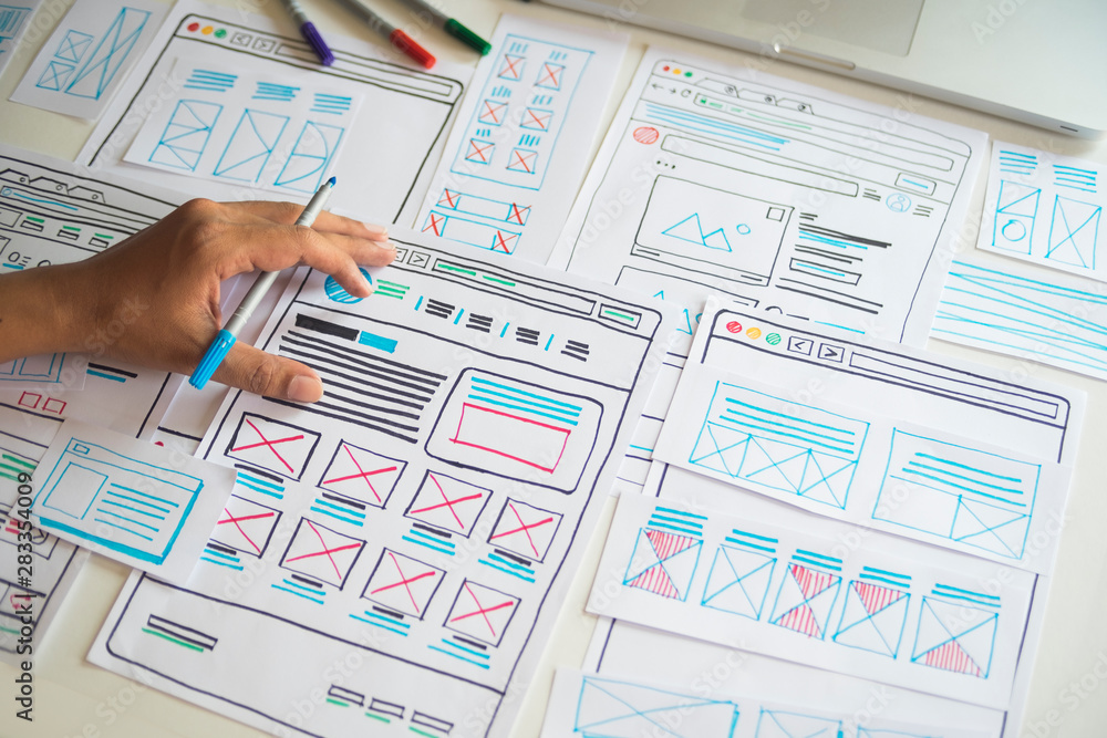 Fototapeta Website designer Creative planning application developer development draft sketch drawing template layout prototype framework wireframe design studio . User experience concept .