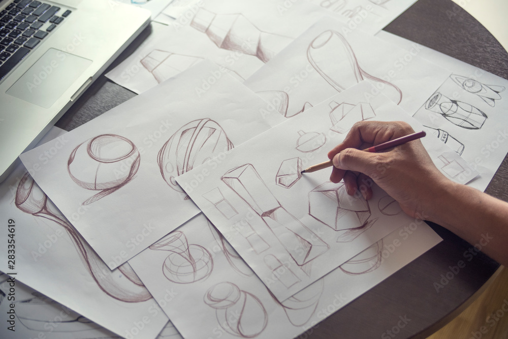 Fototapeta Production designer sketching Drawing Development Design product packaging prototype idea Creative Concept