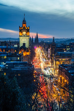 View Of Princes Street With Light Trails In Edinburgh, Scotland, At Dusk