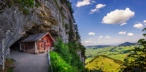 Obraz Historic cabin in the Wildkirchli cave in the Appenzell region of Switzerland - fototapety do salonu