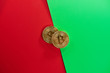 canvas print picture - Physical golden coins bitcoins on a red green background. Digital cryptocurrency concept