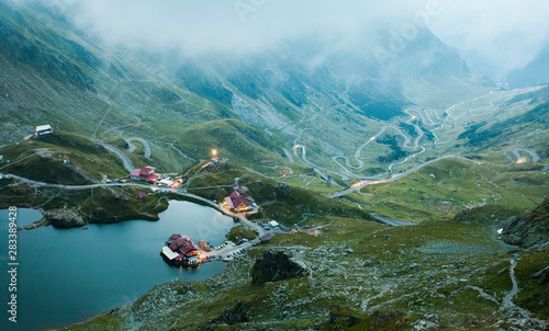 Balea lake in Fagaras mountain, Romania. evening landscape Fotobehang