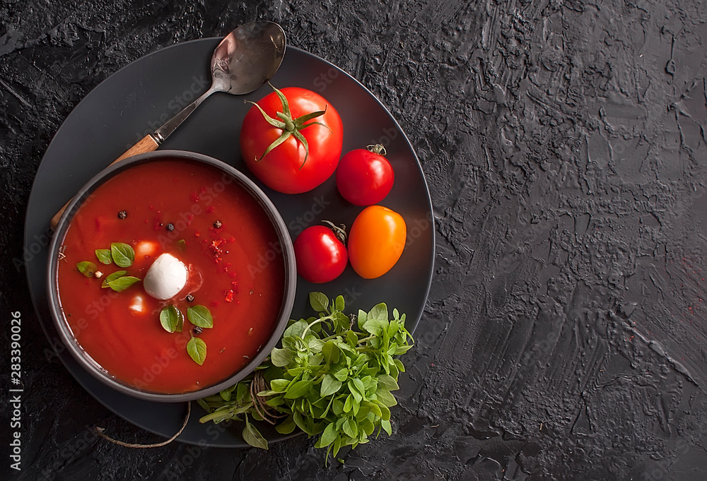 Fototapety, obrazy: Summer cold tomato vegetable soup Gazpacho on the black table. Vegetarian cuisine. Copy space. The view from the top.  The concept of healthy eating.