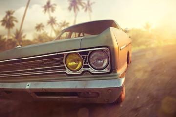 American vintage car in a tropical sunset