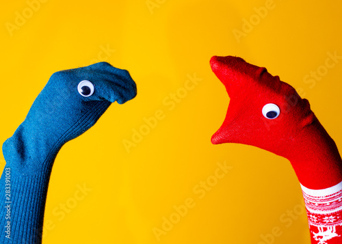Garden Poster Flamingo Red and blue sock puppets argue on the colorful yellow background