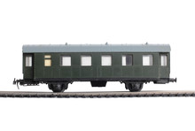 Model Of A Steam Locomotive And Cistern On Rails On A White Background