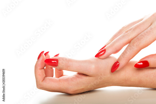 Woman showing manicured hands with red nail polish Fototapeta