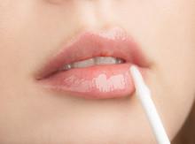 Woman Apply Moisturizing Lip Gloss