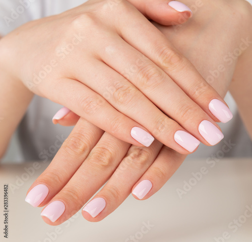 female hand with light pink nail design.... #283396482