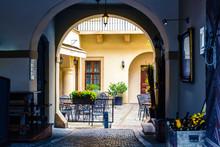 Sidewalk Cafe In The Courtyard, European City