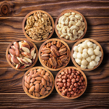 Various Nuts In Wooden Bowls, ...