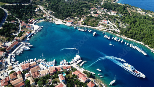 Foto auf Leinwand Blaue Nacht Aerial drone photo from picturesque and iconic port of Fiskardo with luxury boats docked and traditional character, Cefalonia island, Ionian, Greece
