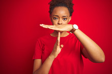 Young Beautiful African American Woman With Afro Hair Over Isolated Red Background Doing Time Out Gesture With Hands, Frustrated And Serious Face