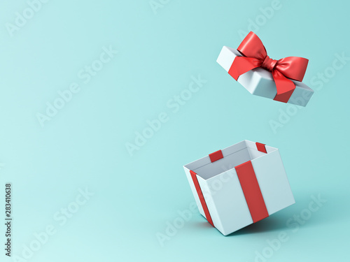Open gift box or present box with red ribbon and bow isolated on green blue past Fototapete