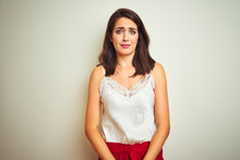 Young Beautiful Woman Wearing T-shirt Standing Over White Isolated Background Depressed And Worry For Distress, Crying Angry And Afraid. Sad Expression.