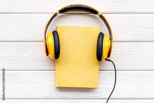 listen to audio books with headphone on white wooden background flatlay Tablou Canvas