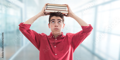 student with books at school and stress expression