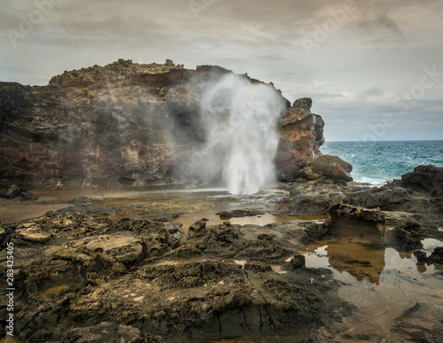 Fotografie, Obraz  Sea water spouting from the Nakalele Blowhole on the northeast coast of Maui, Hawaii