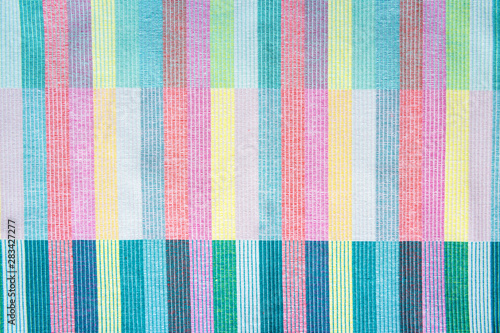 Obraz Colorful textile abstract background in a full frame close-up of woven layers - fototapety do salonu