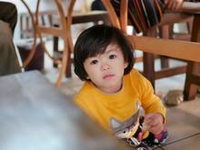 Little Asian Baby Girl Sitting...