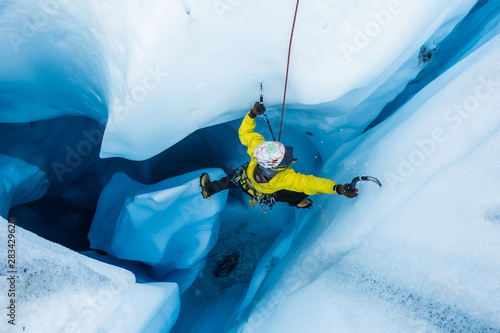 Ice climber on piller inside vertical ice cave on the Matanuska Glacier Canvas Print