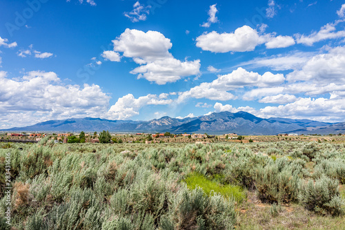 Canvas Prints Olive View of Taos Sangre de Cristo mountains view from Ranchos de Taos valley and green landscape in summer with clouds