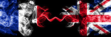 France Vs United Kingdom, British Smoky Mystic Flags Placed Side By Side. Thick Colored Silky Abstract Smoke Banner Of French And United Kingdom, British
