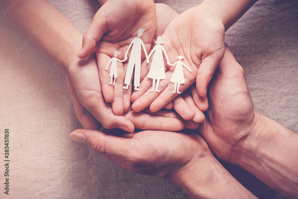 Fototapety, obrazy: Adult and children hands holding paper family cutout, family home, foster care, homeless charity support concept, family mental health