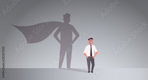 Fototapeta businessman dreaming about being super hero shadow of man with cape imagination
