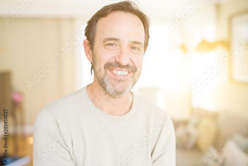 canvas print motiv - Krakenimages.com : Handsome middle age man smiling looking at the camera at home