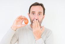 Senior Man Holding Fresh Egg O...