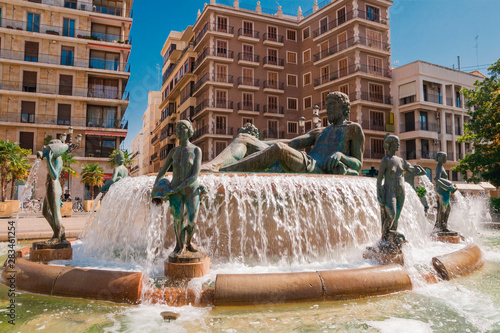 Valencia, Spain - 07/21/2019: A Fountain - Neptune surrounded by eight naked wom Tapéta, Fotótapéta