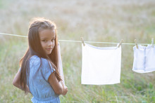 Little Girl Hangs Out To Dry Retro Doll Clothes, Summer Nature Outdoor. Washing, Children's Games, Kid's Leisure, Vintage Housework Style.