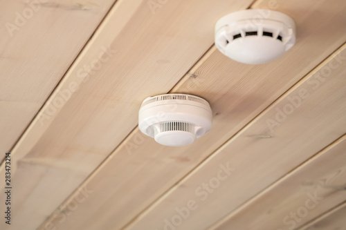 Vászonkép smoke and carbon monoxide detectors in a wooden house