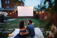 Couple In Love Watching A Movi...