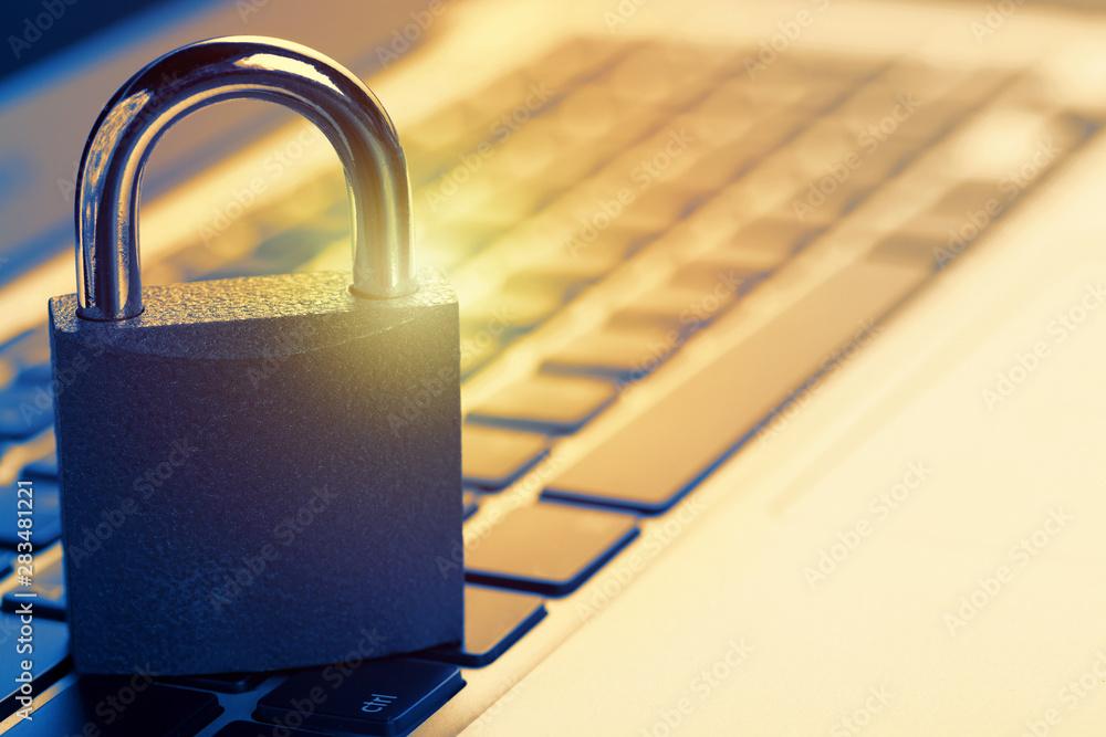 Fototapeta Padlock on laptop. Internet data privacy information security concept. Antivirus and malware defense.