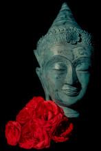 Spiritual Love. Beautiful Blue Buddha Head Statue With Red Roses.