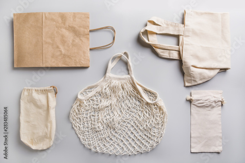 Fototapeta  Paper, cotton and mesh bags for zero waste shopping on grey