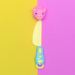 Leinwandbild Motiv Toy plastic knife and piggy Minimal flat lay art