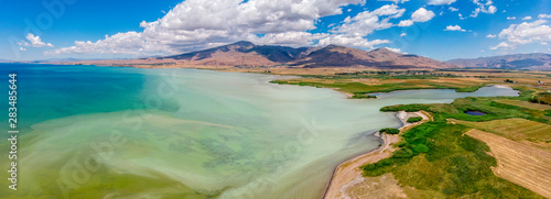 Garden Poster Olive Aerial view of Lake Van the largest lake in Turkey, lies in the far east of that country in the provinces of Van and Bitlis. Fields and cliffs overlooking the crystal clear waters