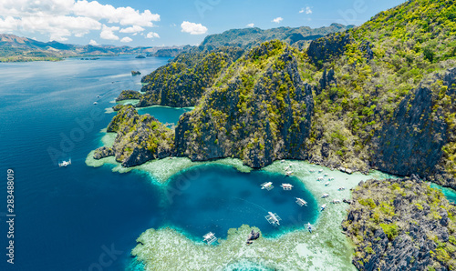 Obraz Aerial view of beautiful lagoons and limestone cliffs of Coron, Palawan, Philippines - fototapety do salonu