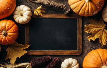 Vintage chalkboard for your message and Autumn background with festive decoration.