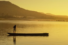 View Of A Fisherman Floating A...