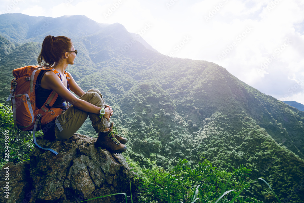 Fototapety, obrazy: Young woman backpacker enjoy the view at mountain peak