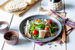 Salad with arugula, tomatoes and prosciutto. Italian cuisine. Healthy eating. Diet.