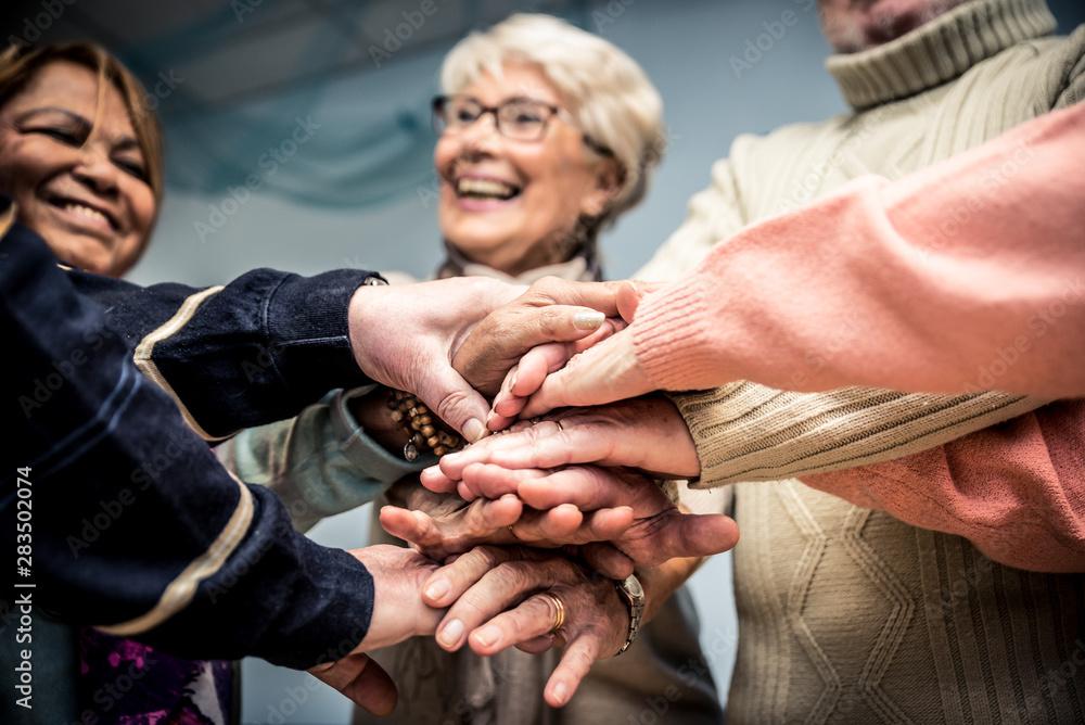 Fototapeta Group of seniors making activities inside the hospice.